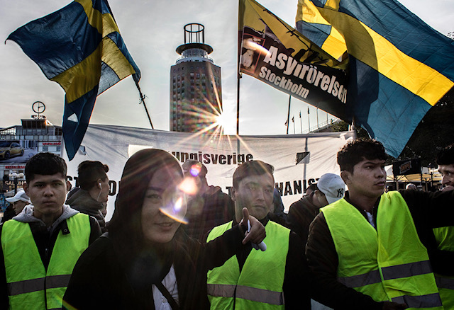 """9/1/ 2017. Stockholm, Sweden. Police presence was big when the demonstrating Afghans wandered from Medborgarplatsen to Norra Bantorget. But the march could move completely without violence. """"We have come to a historic place,"""" said initiative leader Fatemeh Kavari in place in front of the Swedish unions hq LO. Hundreds of people participated in Friday's march when the Afghan refugees, who have manifested at Medborgarplatsen for more than three weeks, moved to Norra Bantorget to continue the demonstration there. On their way through central Stockholm, participants called out slogans to protest against decisions about expulsions to Afghanistan. """"No border, no nation, stop deportation"""" sounded one of the many rams that the large group of people scandalized on the way through the city. Photo: Åke Ericson."""