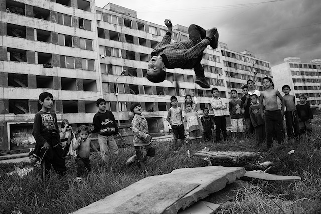 6/28-2013. Lunik IX, Kosice, Slovakia.  A childrens game in the ghetto.Juraj Mizigor doing a backflip.